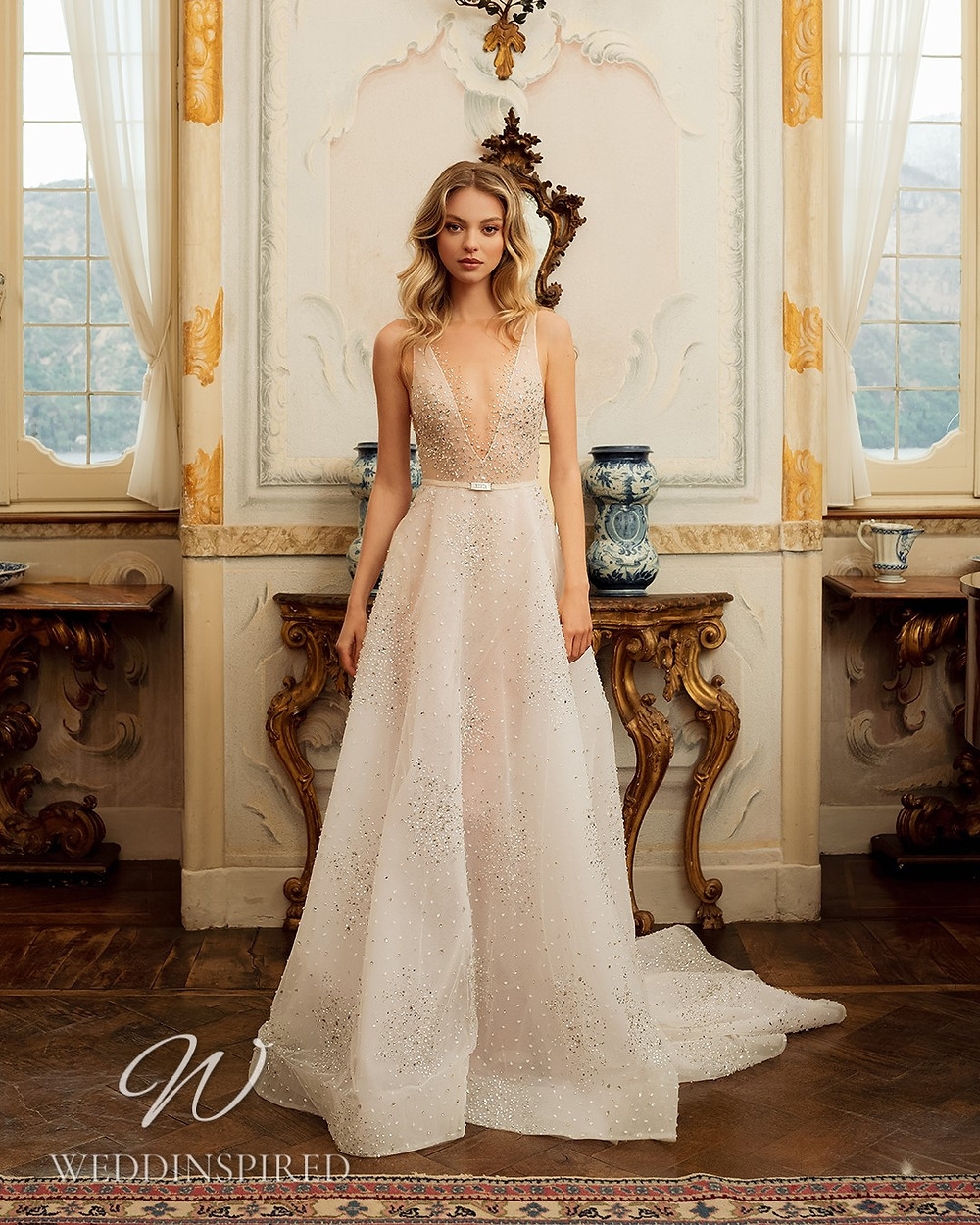 A Berta 2022 tulle A-line wedding dress with a v neck