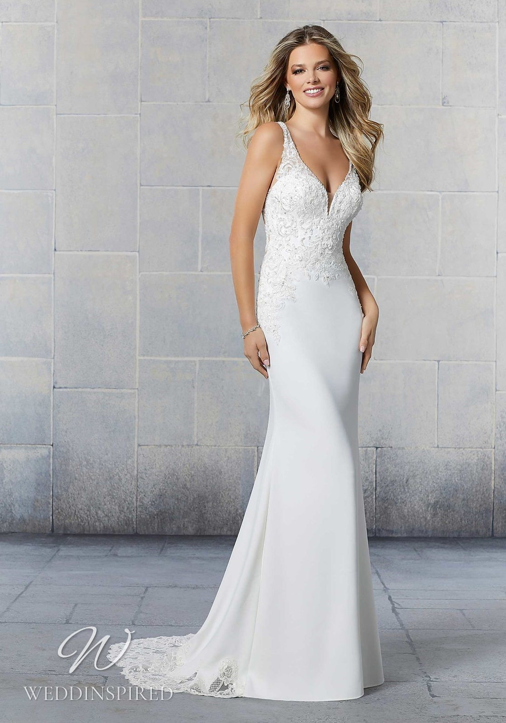 A Madeline Gardner lace and crepe mermaid wedding dress with a v neck