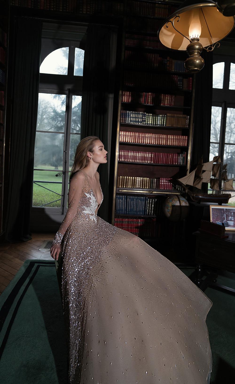 An Inbal Dror sparkly blush and gold ball gown wedding dress