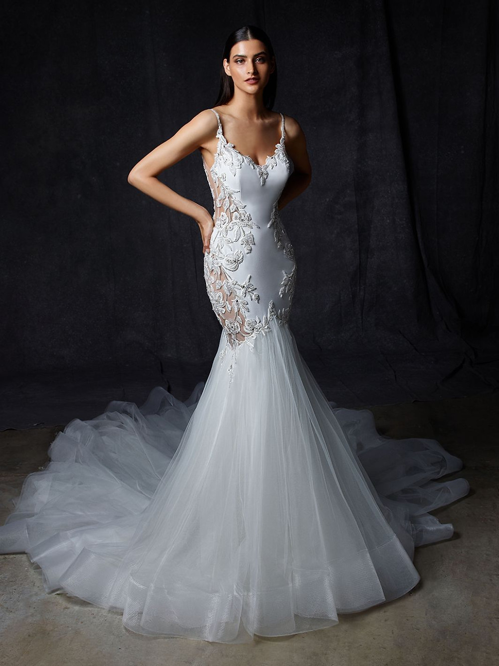 An Enzoani silk mermaid wedding dress with a tulle skirt, thin straps and lace