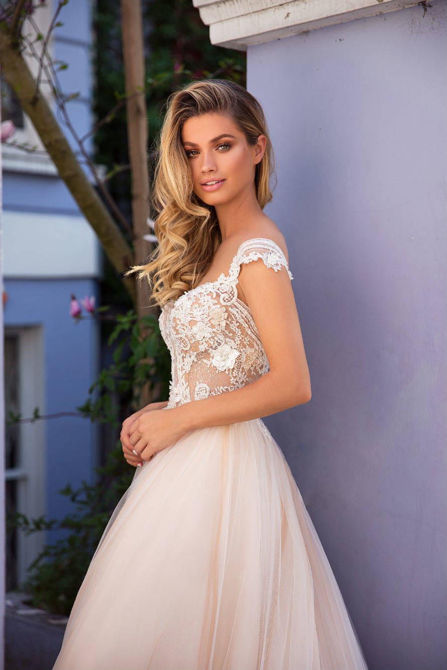 A Milla Nova romantic blush ball gown wedding dress