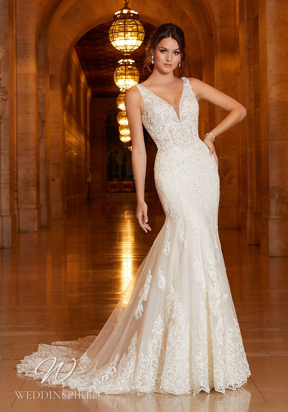 A Madeline Gardner lace mermaid wedding dress with a v neckline and straps