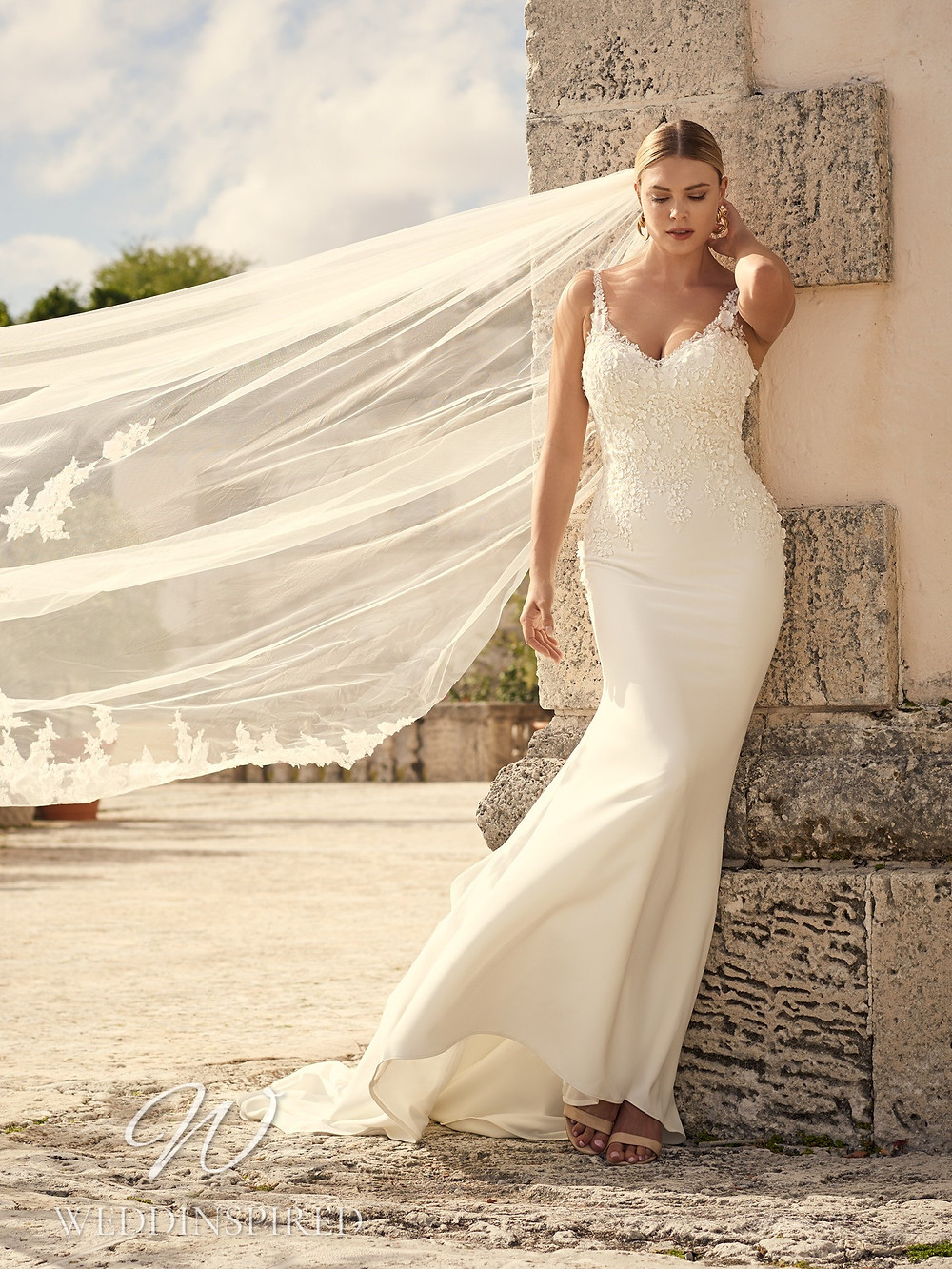 A Sottero & Midgley 2021 ivory lace and satin mermaid wedding dress