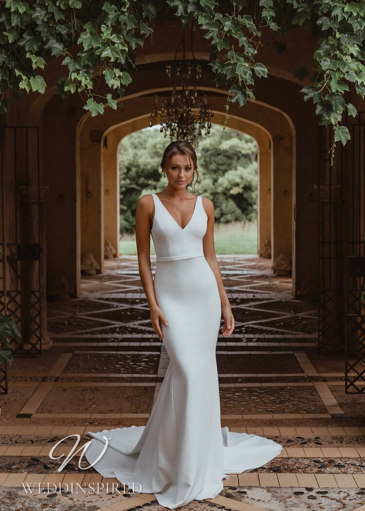 An Anna Campbell 2021 simple crepe mermaid wedding dress with a v neck