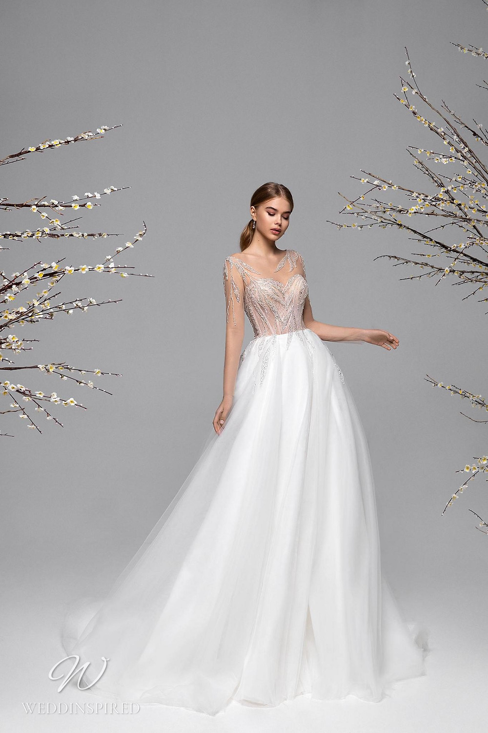 A Ricca Sposa mesh A-line wedding dress with an illusion top