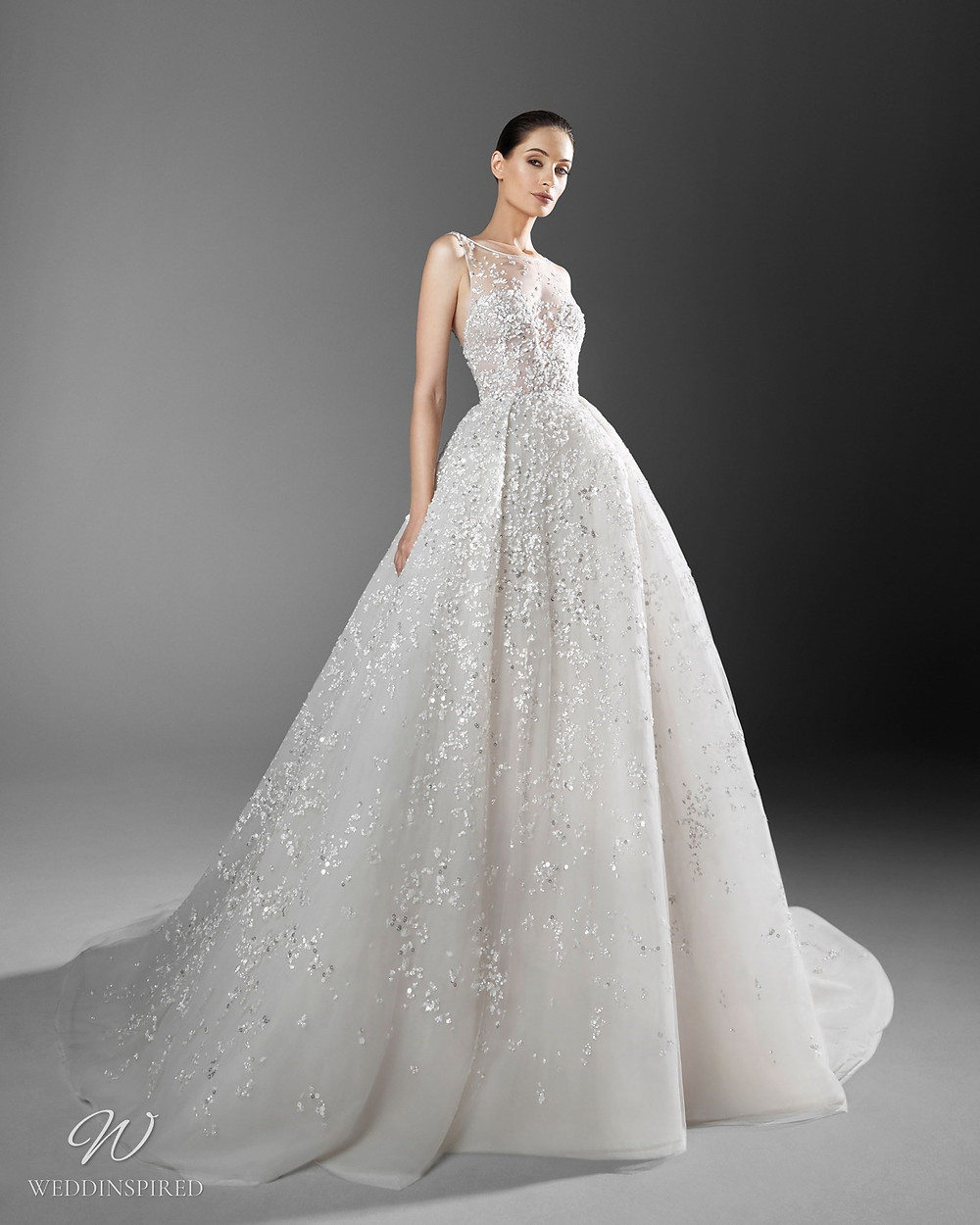 A Zuhair Murad sparkling crystal princess ball gown wedding dress with an illusion neckline