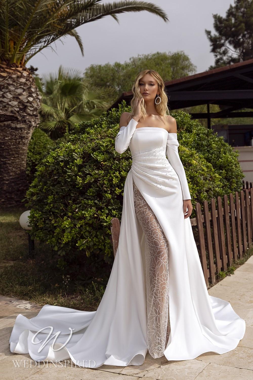 A Tina Valerdi strapless satin mermaid wedding dress