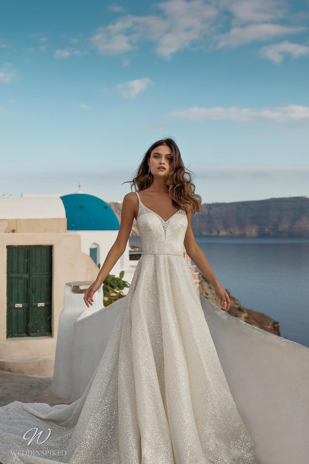 A Ricca Sposa sparkly silver A-line wedding dress with straps and a sweetheart neckline