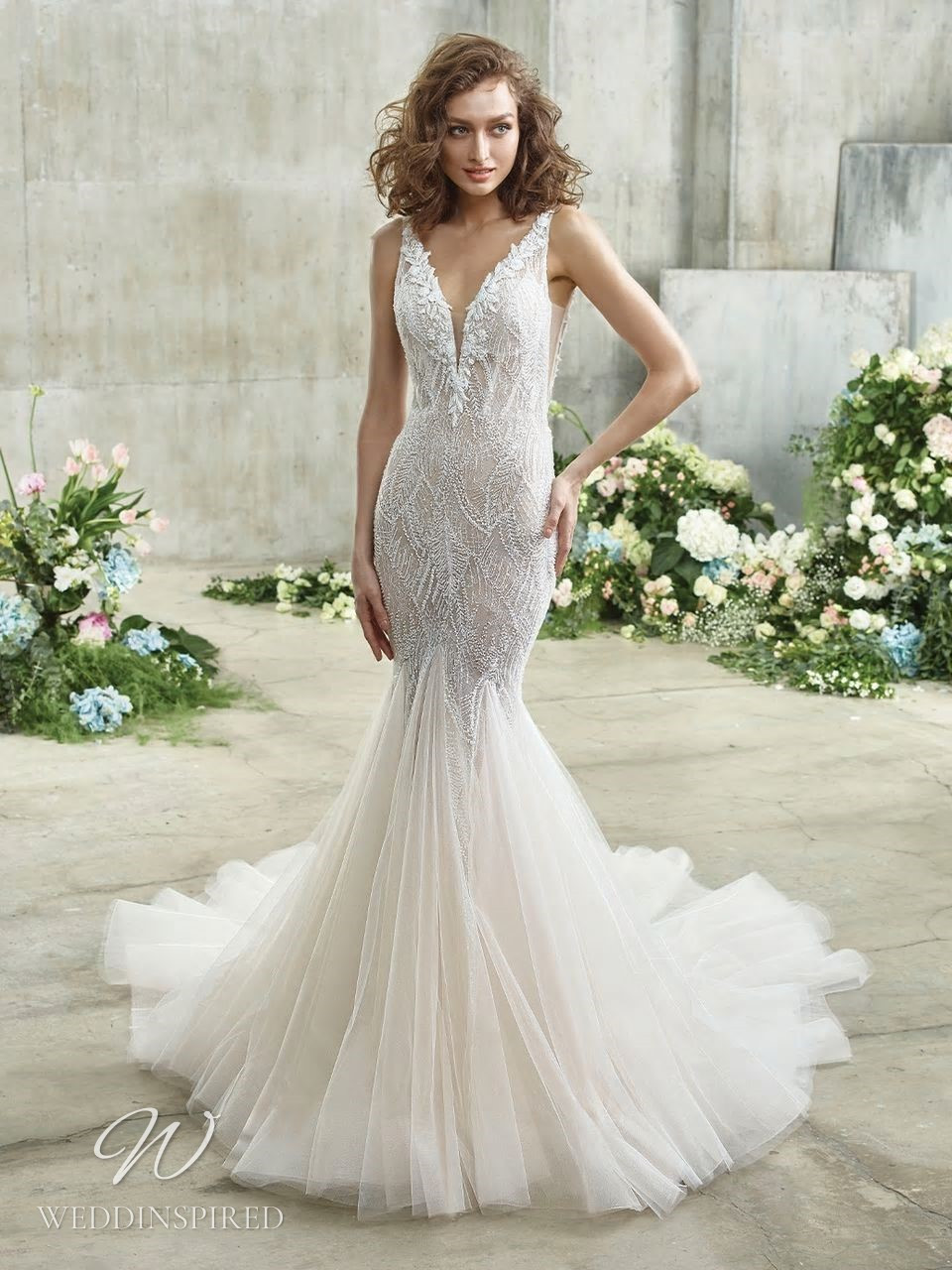 A Badgley Mischka lace mermaid wedding dress with a tulle skirt and a v neckline with beading