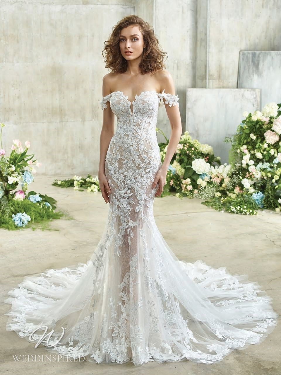A Badgley Mischka off the shoulder lace mermaid wedding dress with a sweetheart neckline and a train
