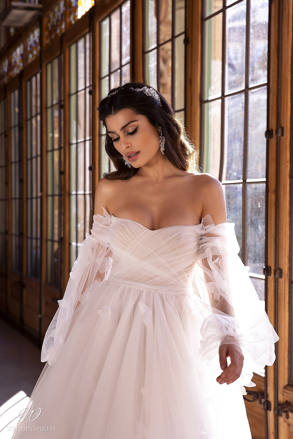 A Maks Mariano tulle off the shoulder princess ball gown wedding dress with long sleeves
