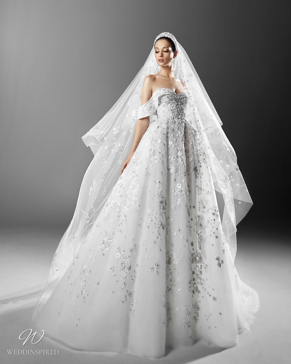 A Zuhair Murad ball gown off the shoulder princess wedding dress with a sweetheart neckline and a veil