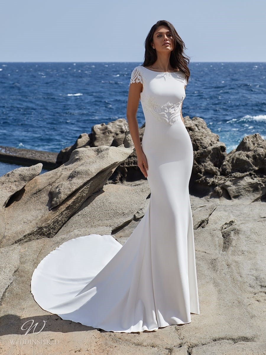 A Pronovias 2021 simple column wedding dress with lace cap sleeves and a train