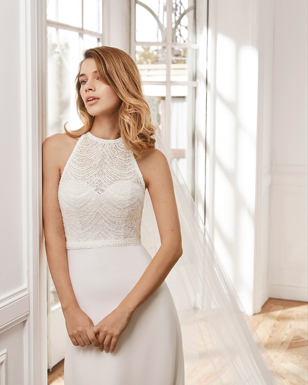 An Aire Barcelona 2020 halterneck crepe mermaid fit and flare wedding dress with beading