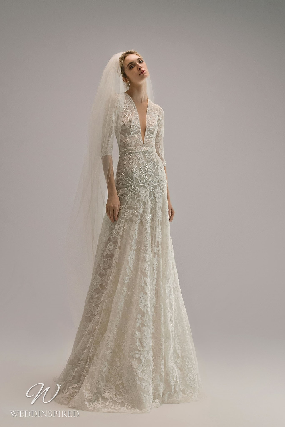 An Ersa Atelier 2021 lace A-line wedding dress with half sleeves and a v neck