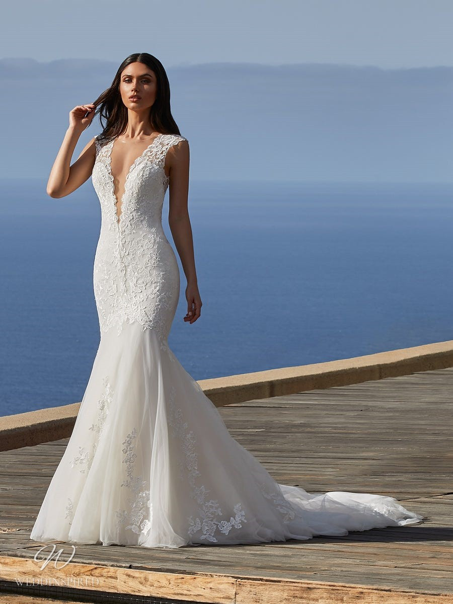 A Pronovias 2021 lace and tulle mermaid wedding dress with a v neckline and a train
