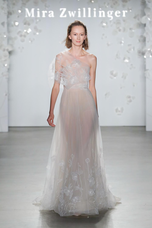 A Mira Zwillinger soft, gauzy sheath wedding dress with flowers