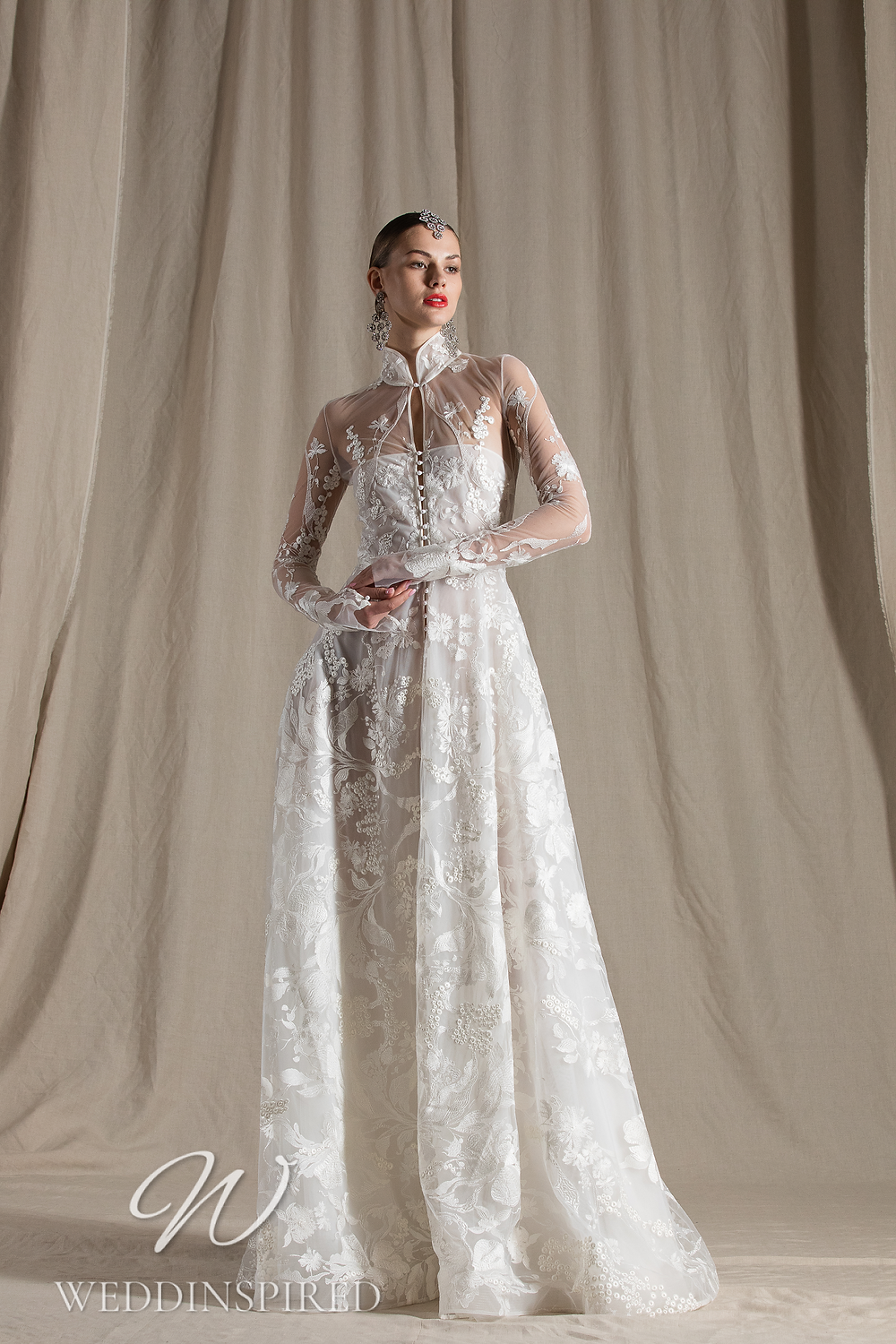 A Naeem Khan 2022 lace and tulle A-line wedding dress with long sleeves