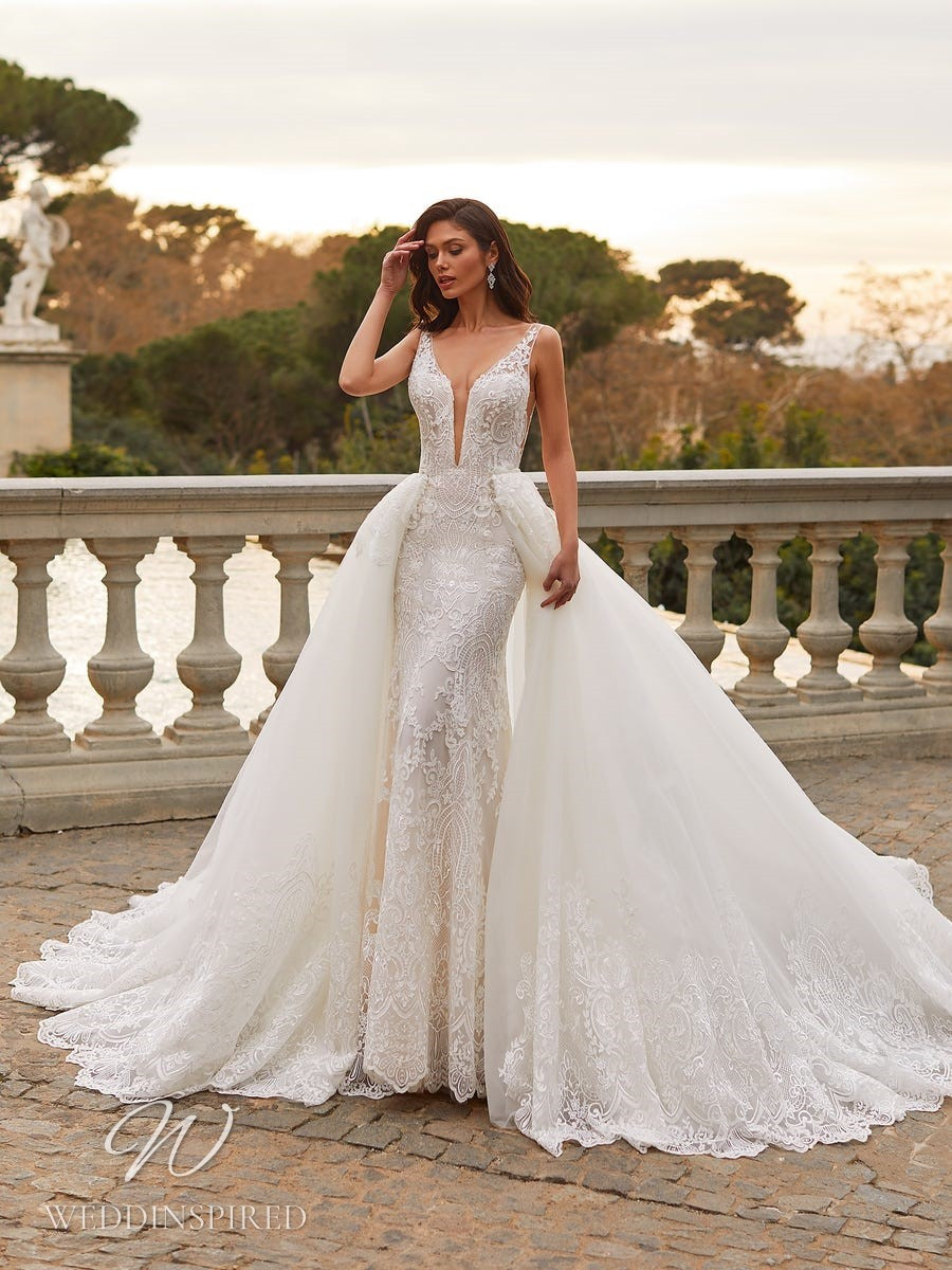 A Pronovias Privée 2021 lace mermaid wedding dress with a detachable skirt, straps and a v neck