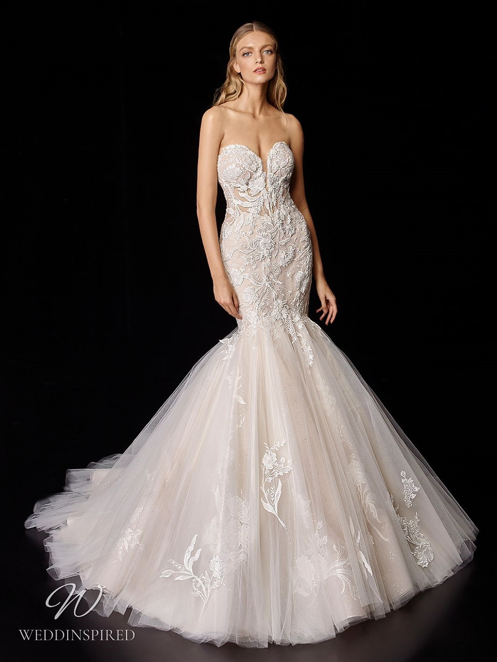 An Enzoani blush strapless lace and tulle mermaid wedding dress with a sweetheart neckline