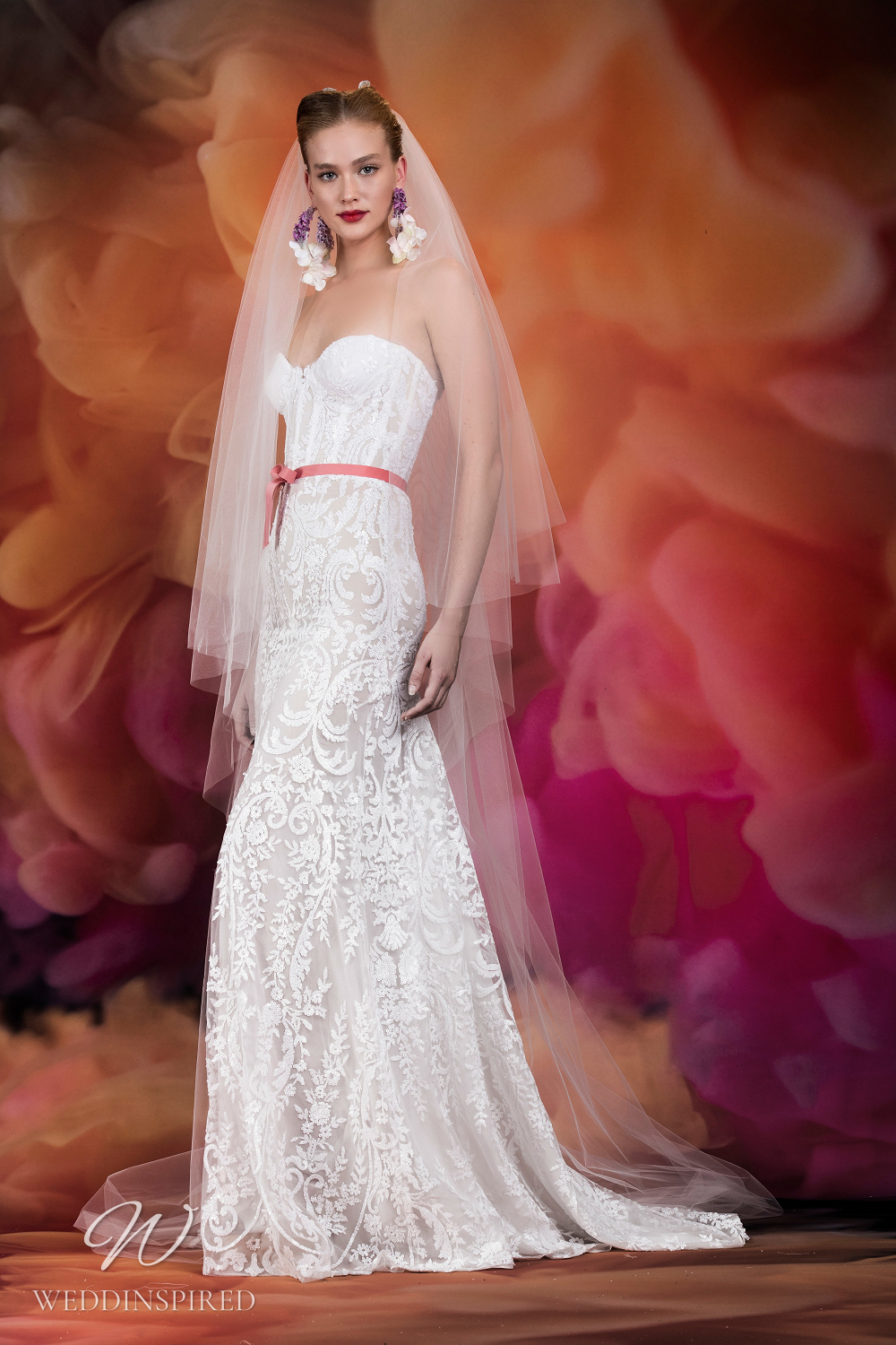 A Naeem Khan lace A-line wedding dress with a sweetheart neckline and bustier top