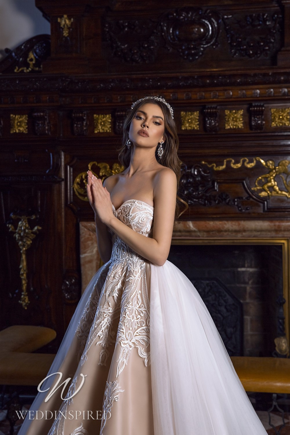 A Maks Mariano blush tulle and lace princess wedding dress