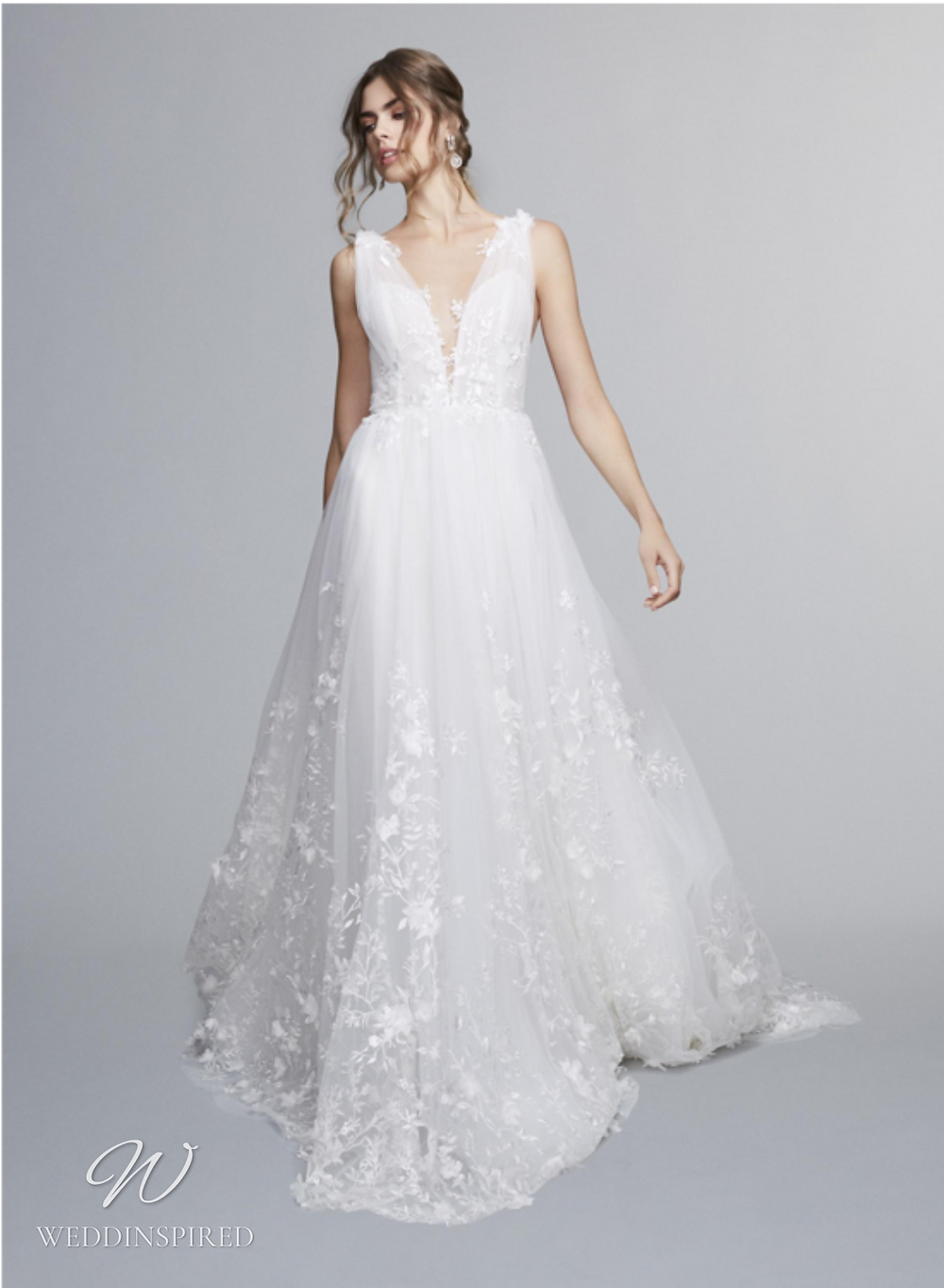 A Marchesa Notte Fall 2021 mesh and tulle A-line wedding dress with thick straps and a v neck