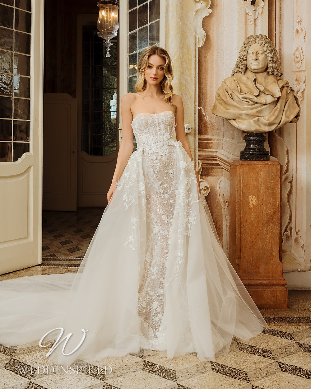A Berta 2022 strapless lace and tulle mermaid wedding dress with a detachable skirt