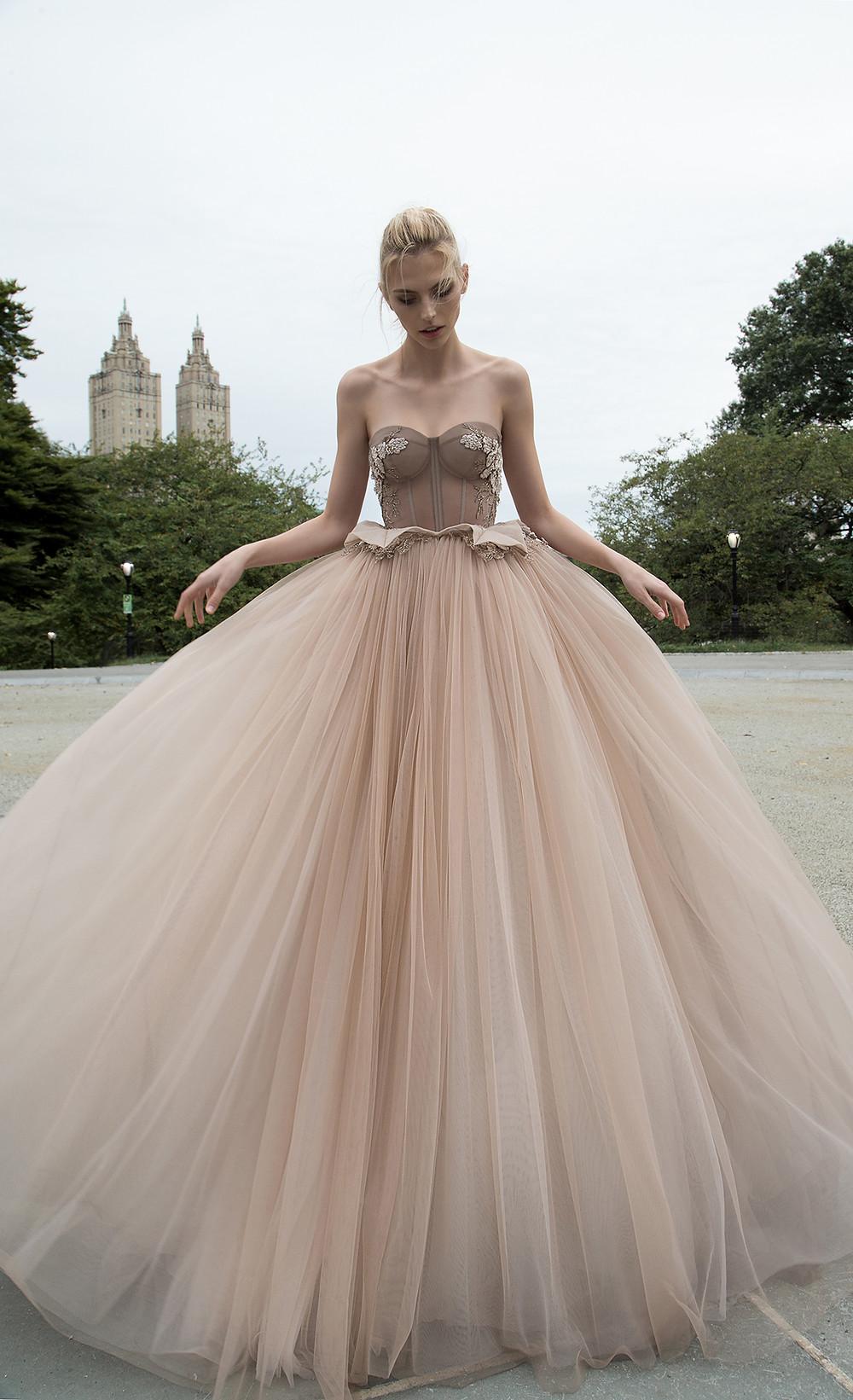An Inbal Dror strapless blush romantic princess ball gown wedding dress