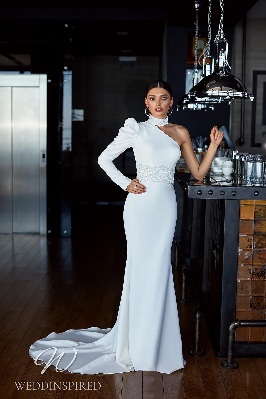 An Ida Torez 2021 one shoulder satin mermaid wedding dress