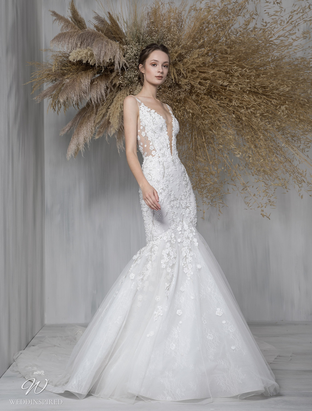 A Tony Ward 2021 lace and mesh mermaid wedding dress with a v neck and straps