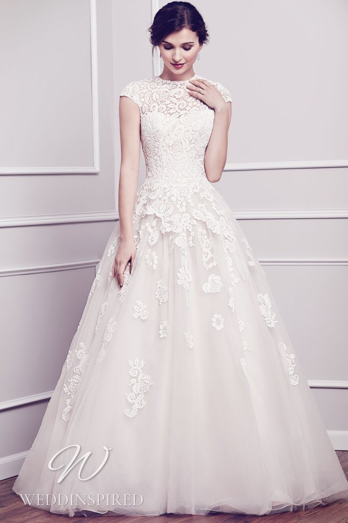 A Kenneth Winston 2021 lace and tulle princess wedding dress with cap sleeves