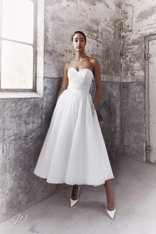 A Viktor & Rolf Fall/Winter 2021 simple strapless tulle tea length wedding dress