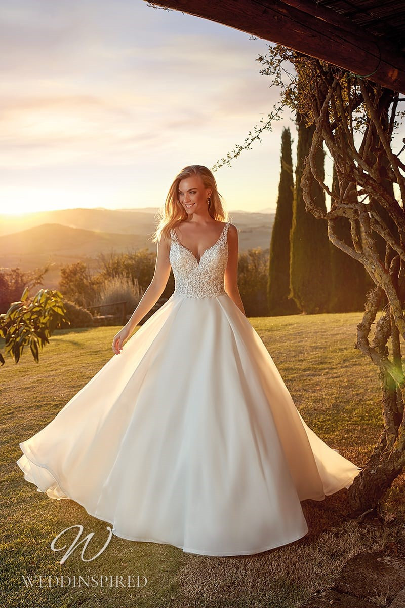 An Eddy K 2021 lace and organza A-line wedding dress