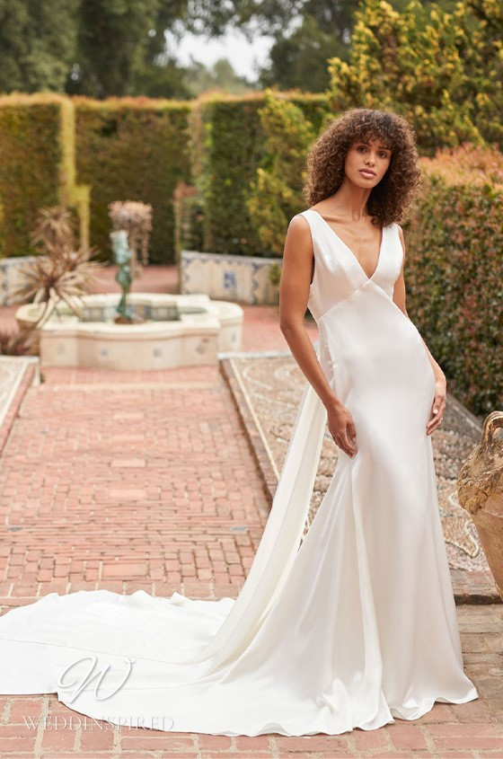 A Monique Lhuillier Bliss Fall 2021 simple satin mermaid wedding dress with a v neck and thick straps