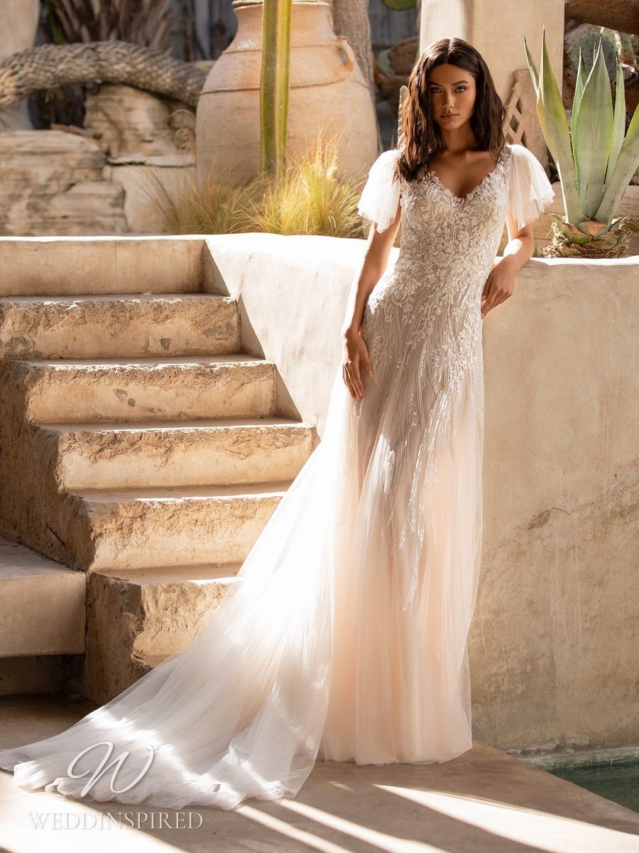 A Pronovias 2021 blush lace and tulle mermaid wedding dress