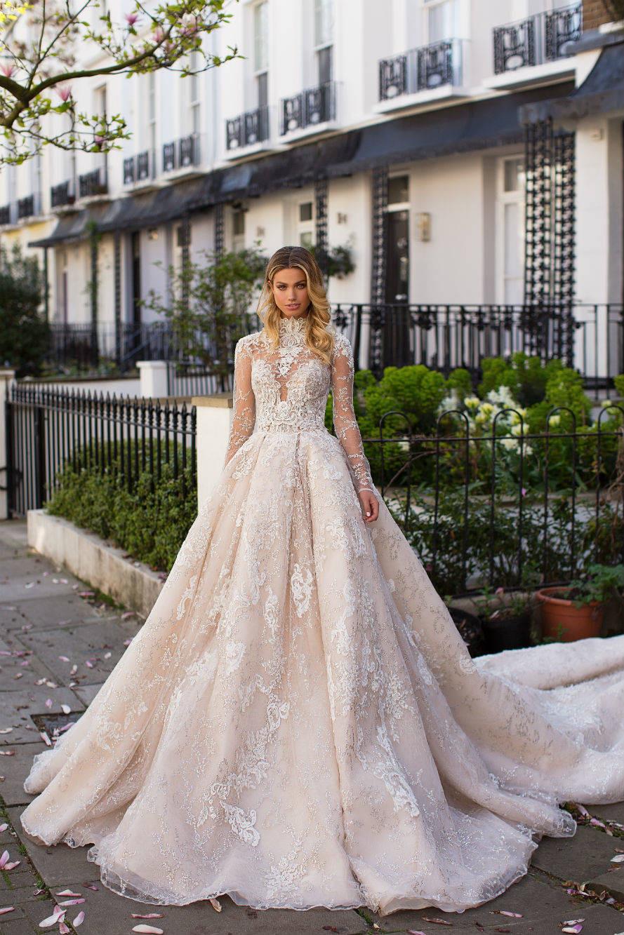 A Milla Nova romantic lace blush princess ball gown wedding dress