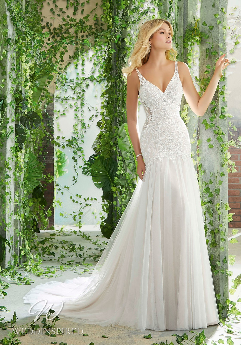 A Madeline Gardner lace and tulle mermaid wedding dress with a v neck