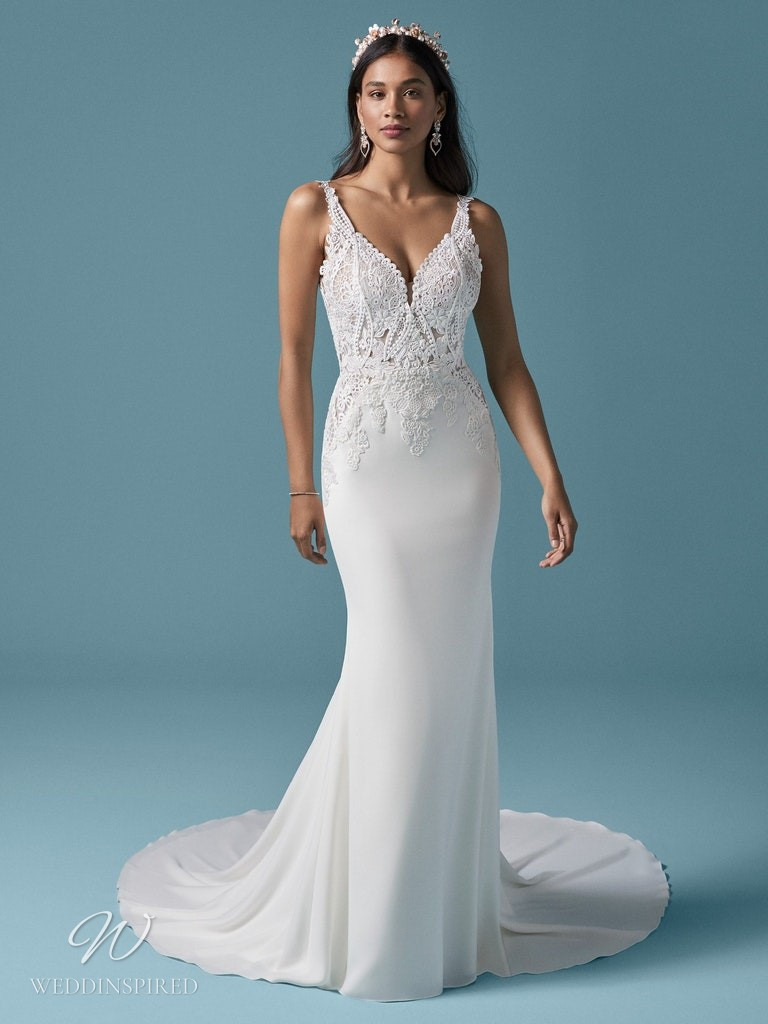 A Maggie Sottero 2021 lace and crepe mermaid wedding dress with straps