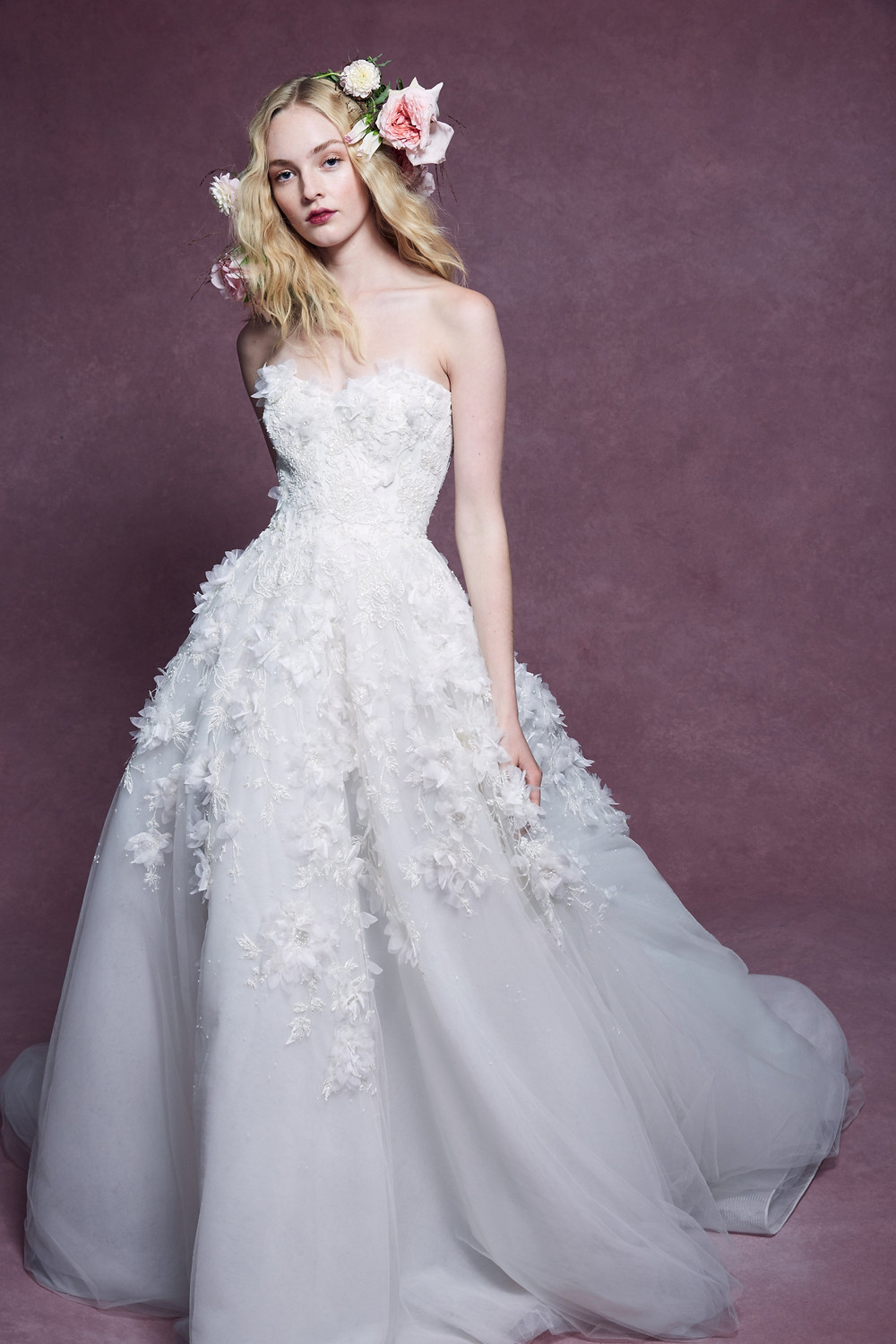 A Marchesa 2020 tulle ball gown wedding dress with sweetheart neckline corset top and flowers