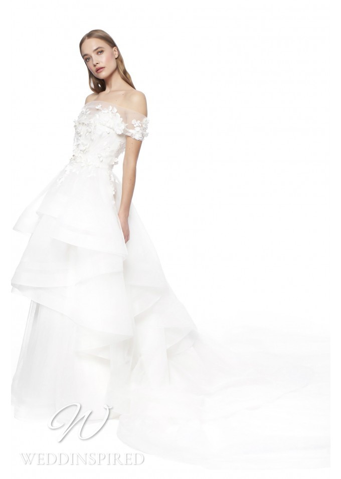 A Jenny Packham 2021 off the shoulder tulle A-line wedding dress with a ruffle skirt