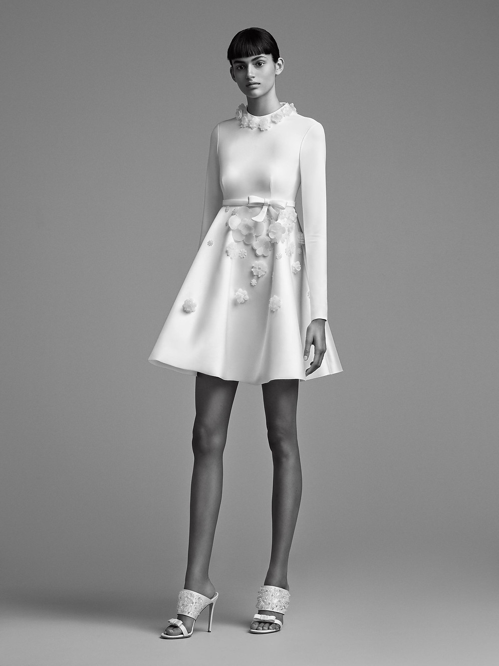 A Viktor & Rolf short crepe wedding dress with long sleeves