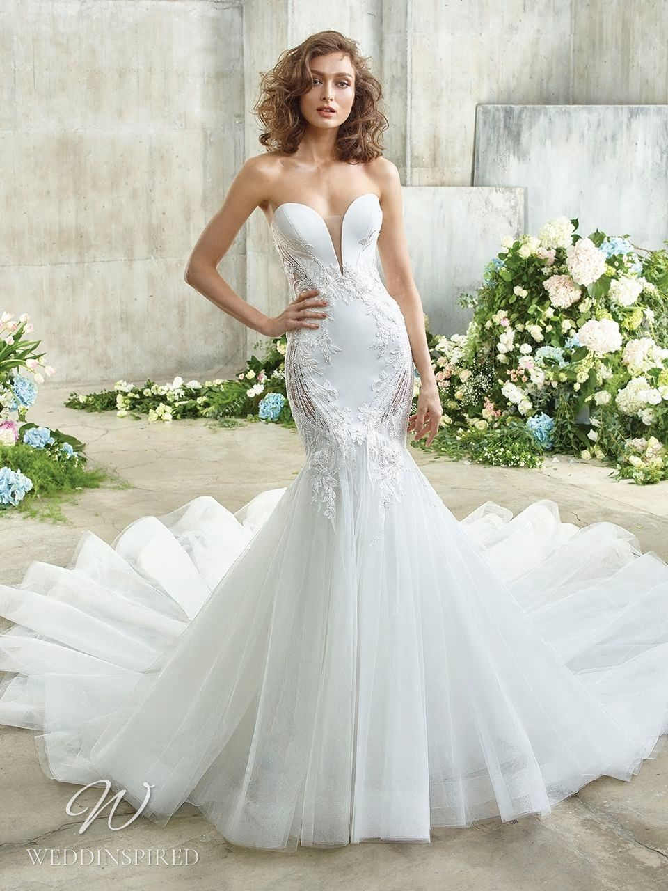 A Badgley Mischka mermaid wedding dress with a tulle skirt, embroidery and a sweetheart neckline