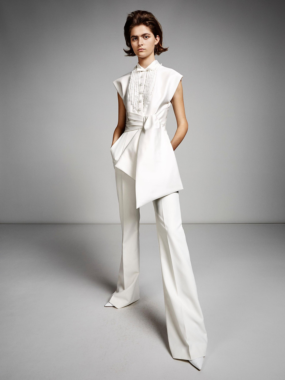 A Viktor & Rolf wedding jumpsuit or pantsuit with a bow