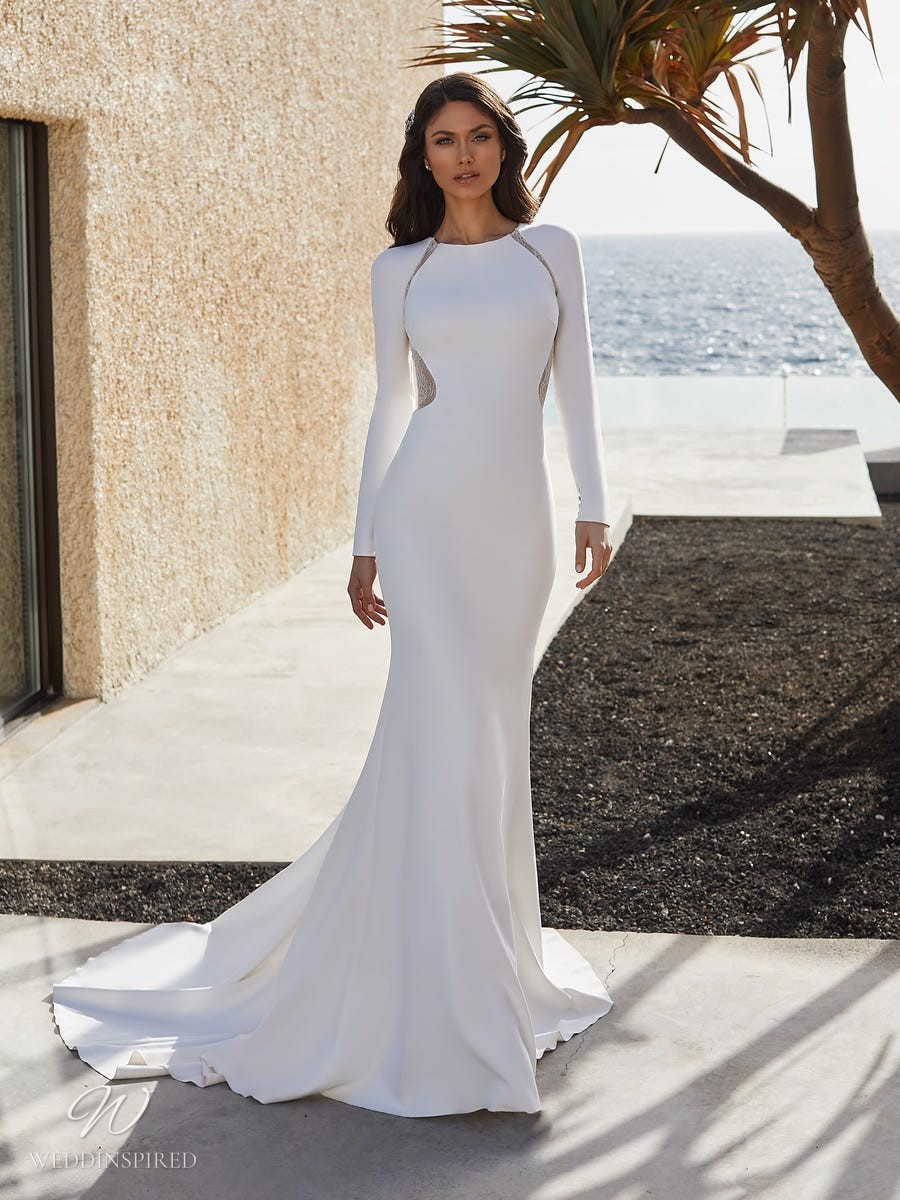 A Pronovias 2021 modest mermaid wedding dress with long sleeves and a train