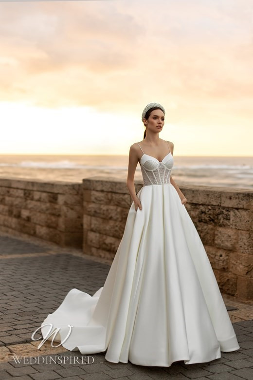 An Ida Torez 2021 silk ball gown wedding dress with a bustier top and thin spaghetti straps
