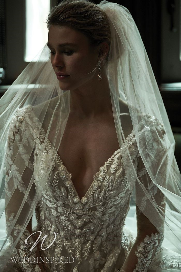 A Justin Alexander 2021 lace A-line wedding dress with long sleeves