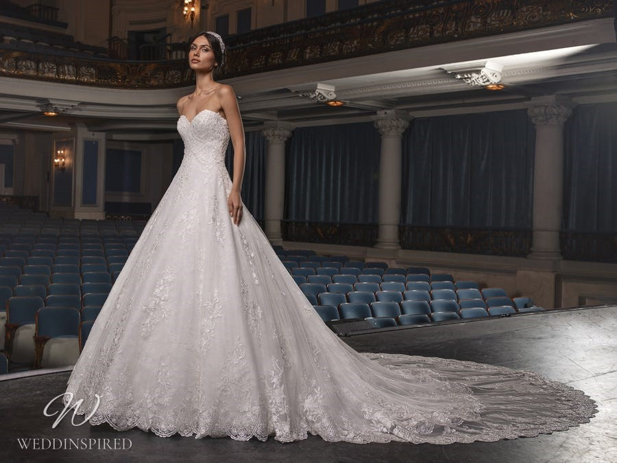 A Pronovias Privée 2021 strapless lace princess ball gown wedding dress with a sweetheart neckline and a train