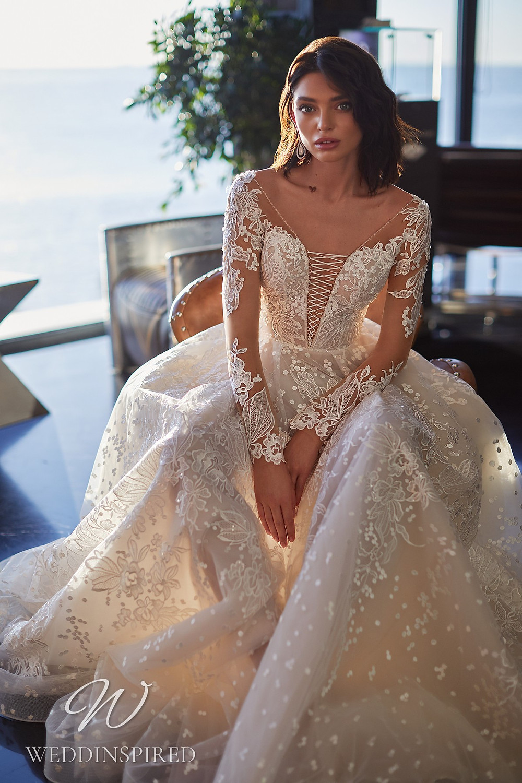An Ida Torez 2021 lace A-line wedding dress with long sleeves