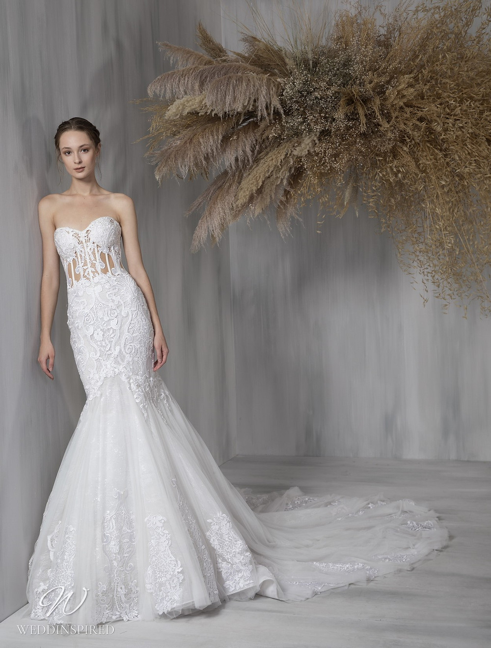 A Tony Ward 2021 strapless lace mermaid wedding dress with a train and a sweetheart neckline